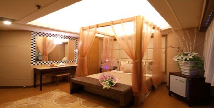 台中哈密瓜时尚旅馆房间室内图、外观图