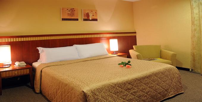 台北东姿商务旅店房间室内图、外观图