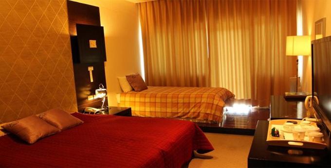 南投农场国民宾馆房间室内图、外观图